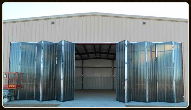A Horton Stack Door creates a space saving system that can operate even during a power outage. & Steadfast Structures Inc. - Airport Hangars \u0026 Museums